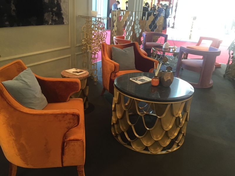 Gold round coffee table with orange velved armchairs