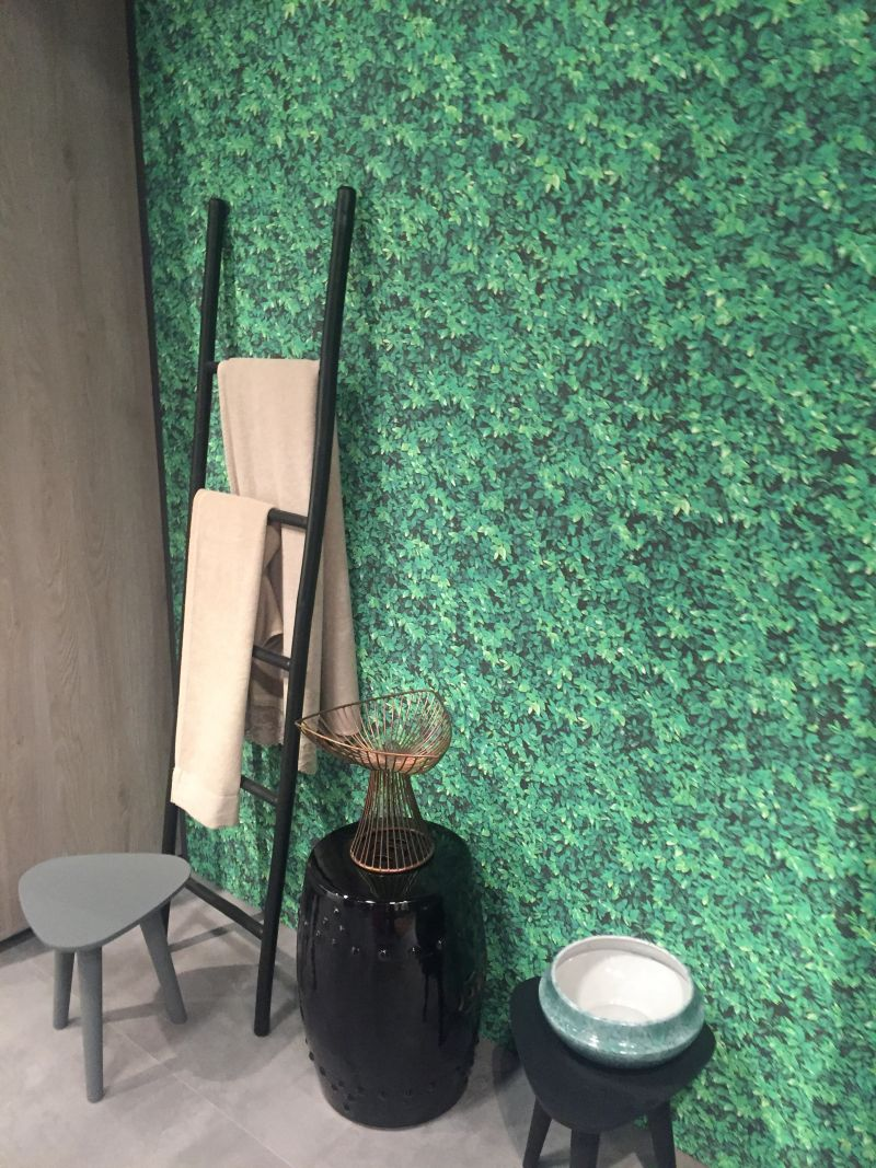 Green bathroom wallpaper and black accessories