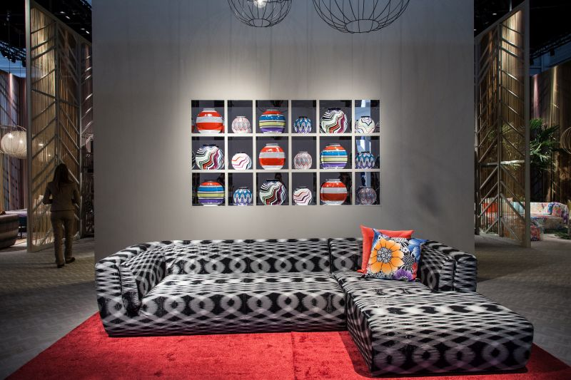 Grey pattern sofa and built in wall shelves
