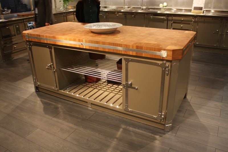 High-end Italian kitchen company Officine Gullo adds a luxe wood butcher block countertop to their island.
