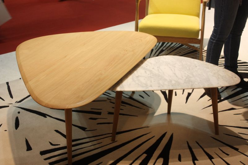 These side tables from Haymann also have three legs and can work together as a coffee table set or individually as a side table. Again, while both are dome with different finishes, the three legs and repeating shape help them work together.