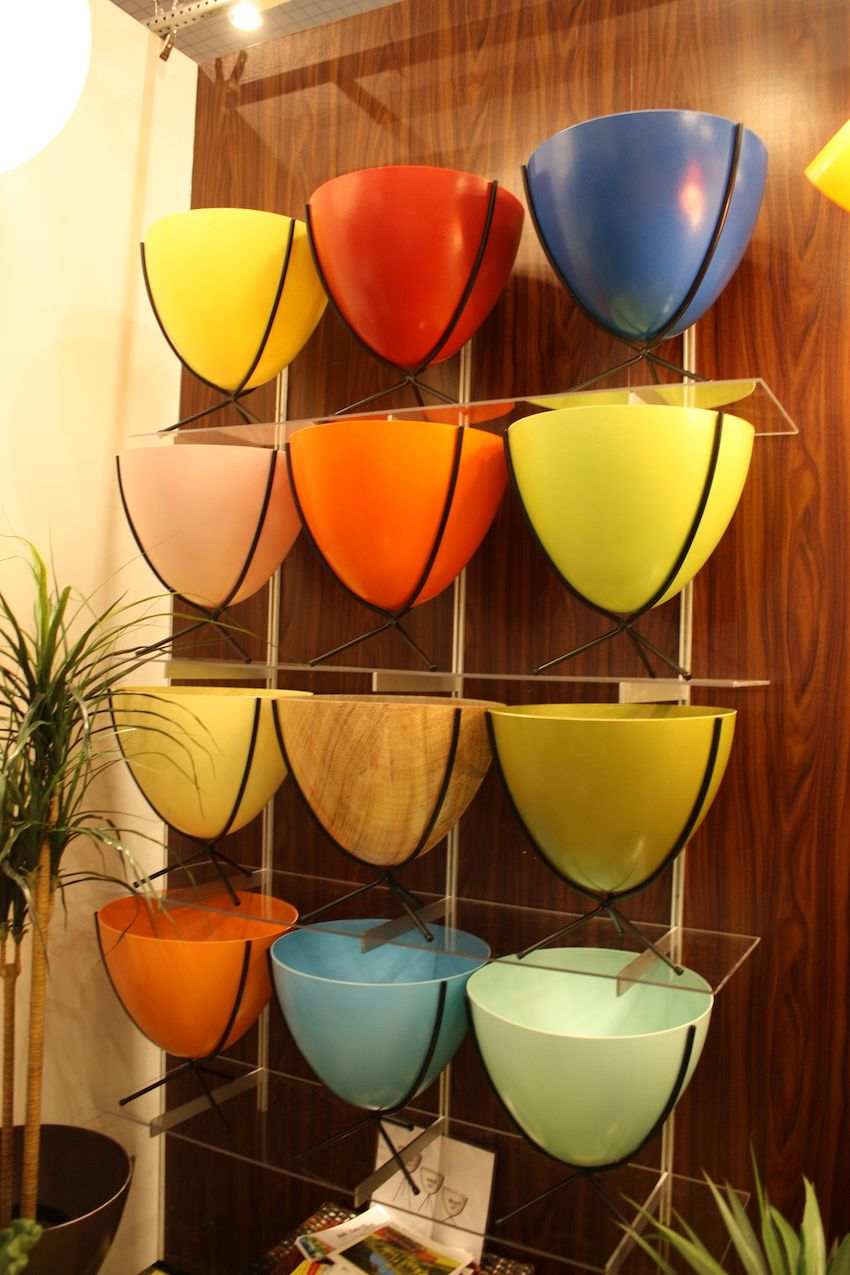Hip Haven was introducing new light fixtures this year, but we're still smitten with their colorful pots. Their retro bullet planters come in different sizes and colors. We love them all!