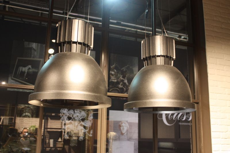 This industrial style spotlight design was popular for kitchen island lighting in many brand exhibits. The gray metallic tone of this one shown by Cucine Lube makes it a versatile, neutral fixture.