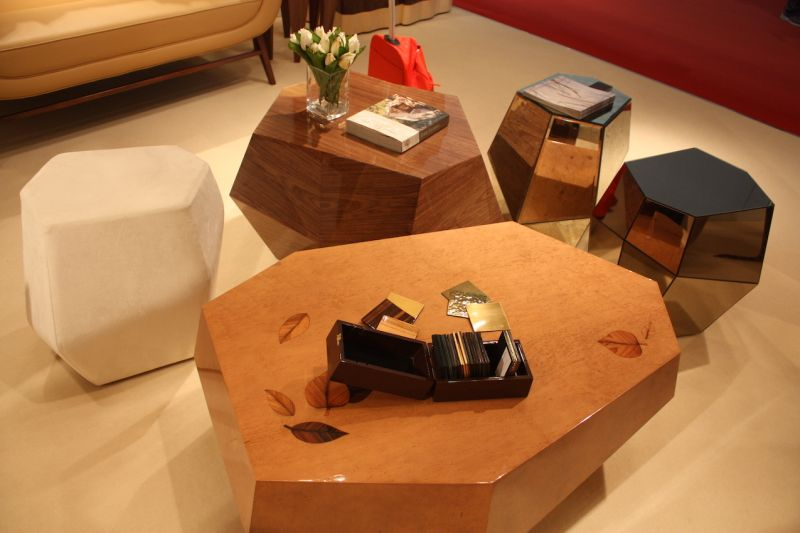 Wooden coffee tables by Insideherland are randomly geometric and stunningly beautiful. The marquetry work is done in smoky brownbird'seye, rosewood, ebony and olive tree veneers, covered with a high gloss varnish.