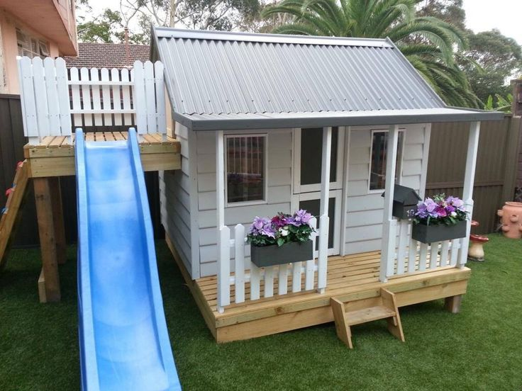15 pimped out playhouses your kids need in the backyard for Playhouse with porch plans
