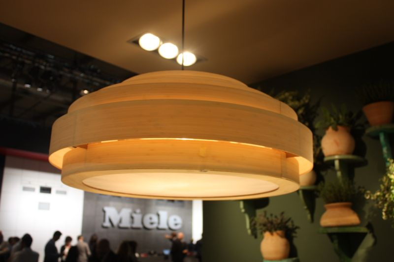 For a more natural look, Ilve incorporated this kitchen pendant light fixture made of concentric circles of wooden bands.