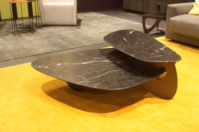 Knoll products don't disappoint and that's certainly the case with this bi-level coffee table. The rounded planes of the marble tops and the supports are marvelous.