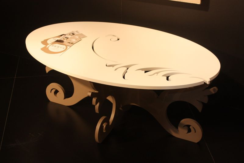 It might look like a more traditional table with fancy features, but this wood coffee table is made with the latest in laser technology. Laser Art Style of Italy creates table, mirrors and all sorts of decor using laser cutting technology.