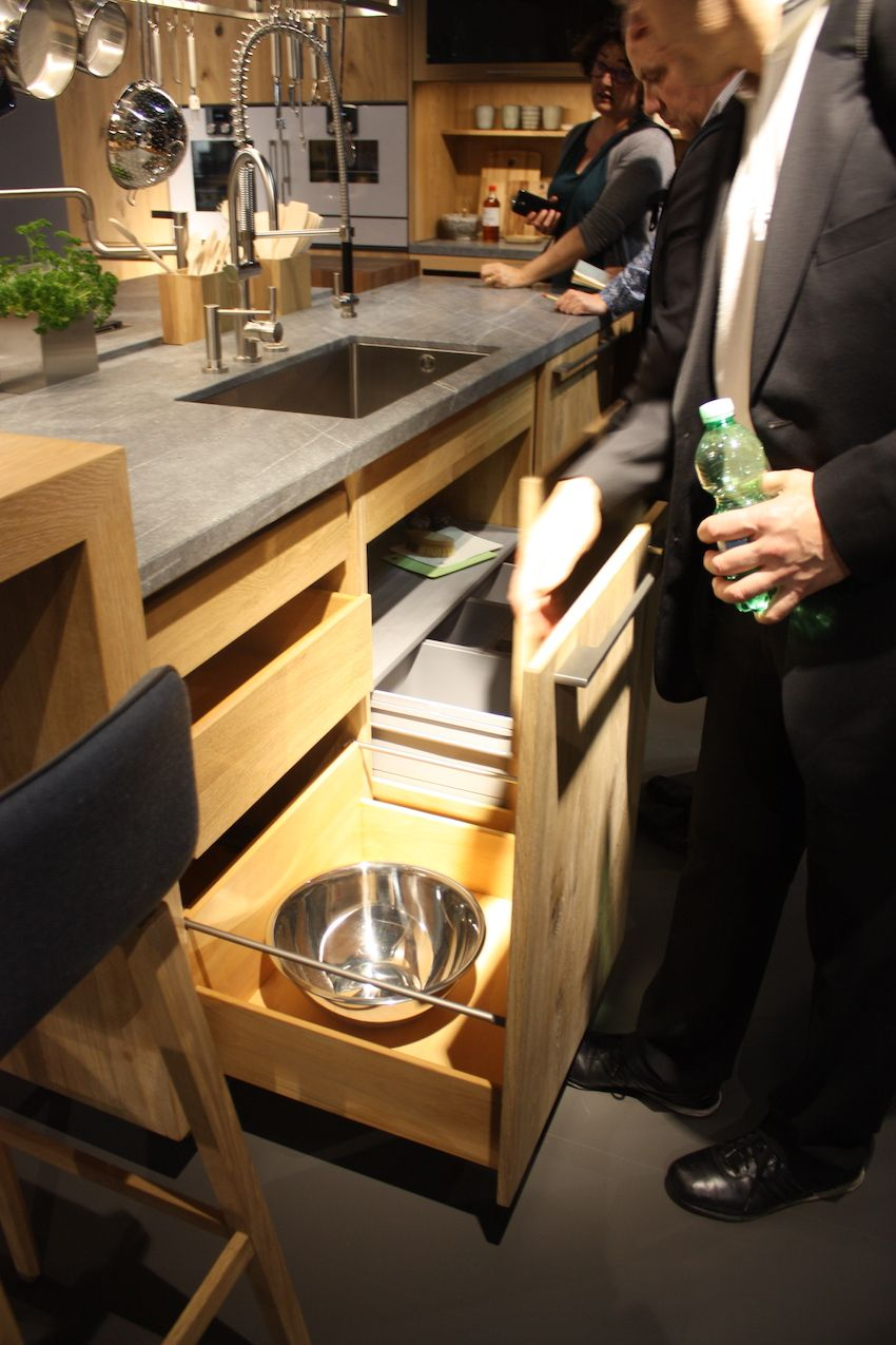 The light wood kitchen cabinets include the same wood in the pull-out drawers inside the cabinets.