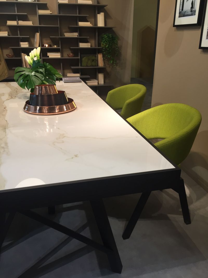 Marble table with green chairs