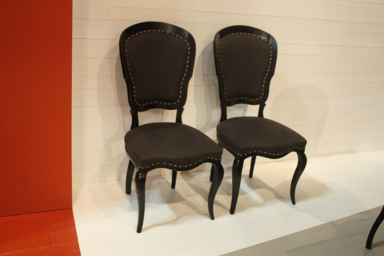 For those who like a more traditional style, these dining chairs by Marchetti are stately with an interesting shape. The graceful legs are particularly enticing.