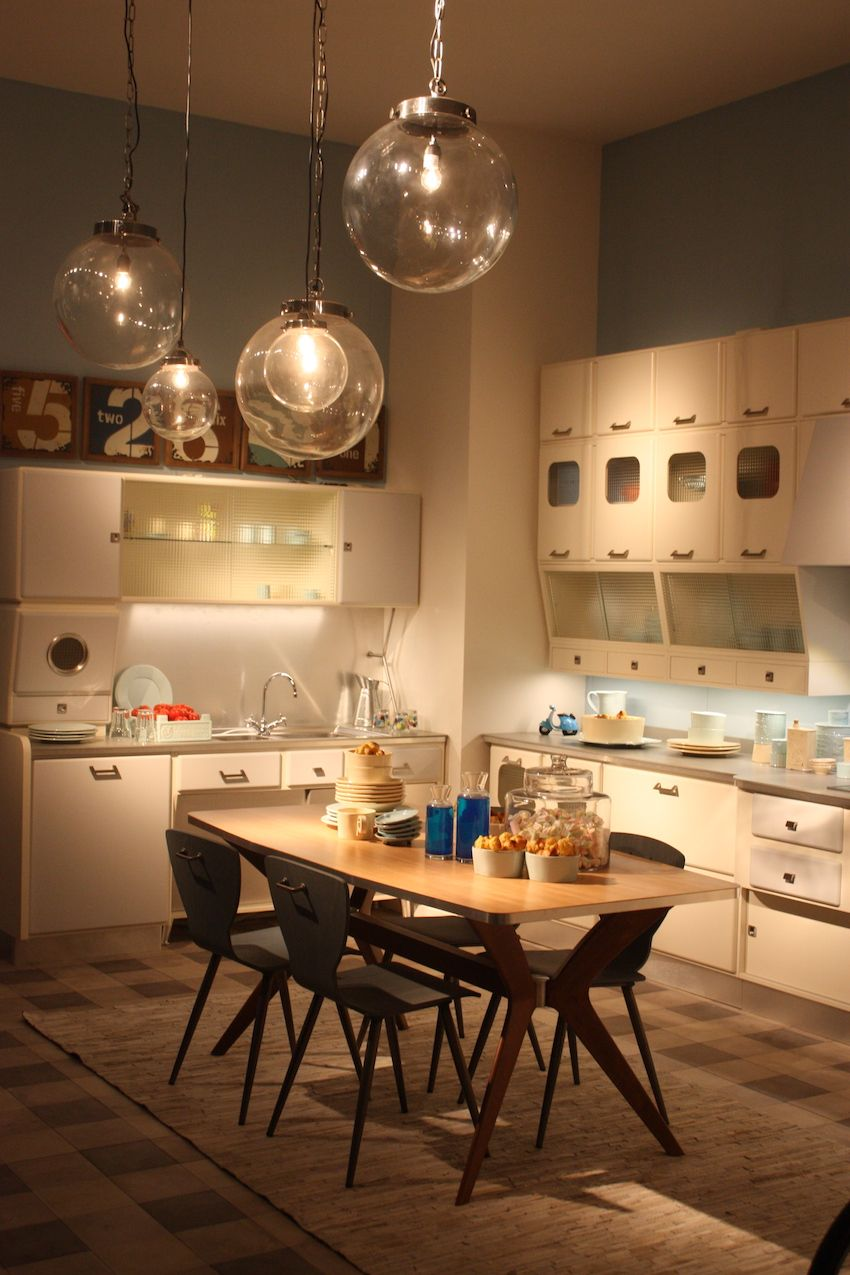 A retro style kitchen like this one by Marchi is the perfect place for clear glass globe pendants in varying sizes. Kitchen pendant lighting like this is versatile, thanks to the glass and minimalist style.