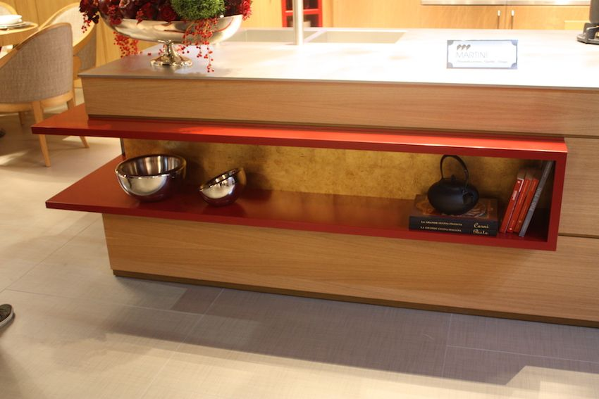 Martini showed this modern wood kitchen island that has a bold red accent. In a show of mixed styles, the wood cabinets surrounding the island had both contemporary and traditional accents.