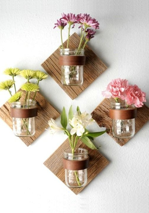 Mason jars flowers on wall