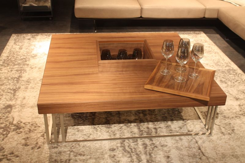 Acclaimed for its seating and sofas, MaxDivani also has this great wood coffee table that has a tray and secret storage. perfect for the who like to entertain, its fun as well as useful.