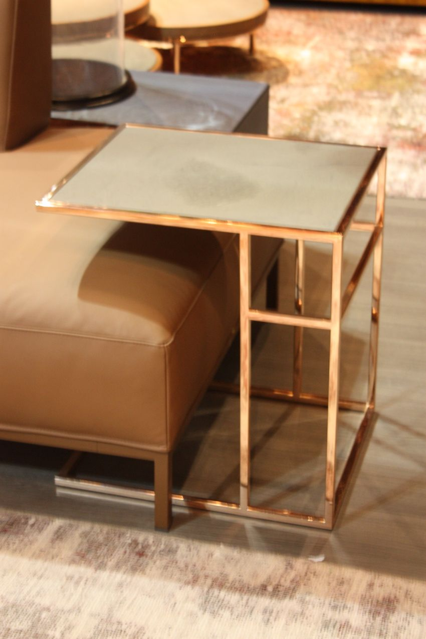 An eclectic mix of wood and metal balls come together in a compact but functional side table from Munna Design.