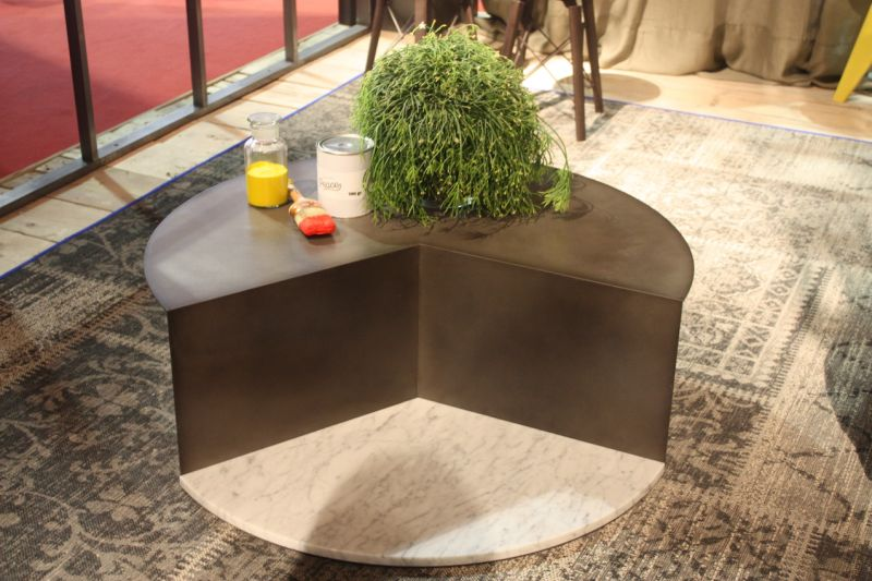 It may look like a cake missing a slice, but this Coco coffee table from Colico is not missing any style. The marble base in the front anchors the metal section, which has a single metal support underneath. Turned toward a sofa, the table makes the room feel more open because it does not have a full, large round top.