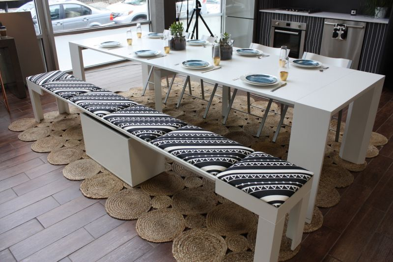 Can you believe that small console becomes this large dining table? whether you live in a small space or just need extra dining space for the occasional party, this is a fantastic design. The multiple expansion leaves store separately. The bench also collapses into a single unit, with all the cushions stored in the central box underneath. Oh, and by the way, the bench fits under the closed console table.