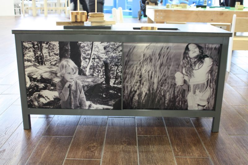 Among the customizing options is the possibility of having your own photos put onto the sliding doors of the cabinet. We love the black and white photos incorporated into this cabinet. You could also have your children's own artwork on the panels.