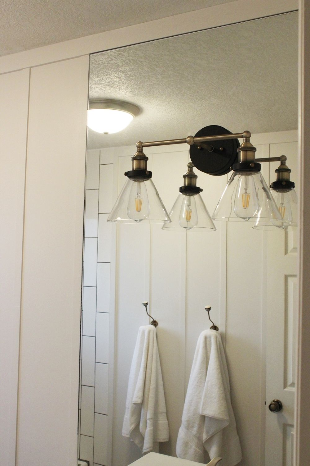 how to mount bathroom mirror how to mount a light on top of a mirror bathroom vanity 23442