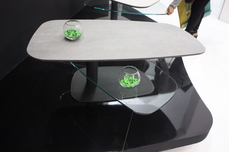This multilevel coffee table has levels that spin around the central post that imposition at one end. Entertaining a crowd is easy with this style of table, which lines back up to it's original footprint.