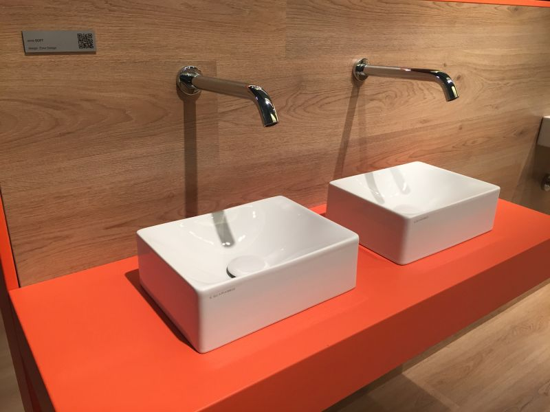 Orange double vanity with small wash basin