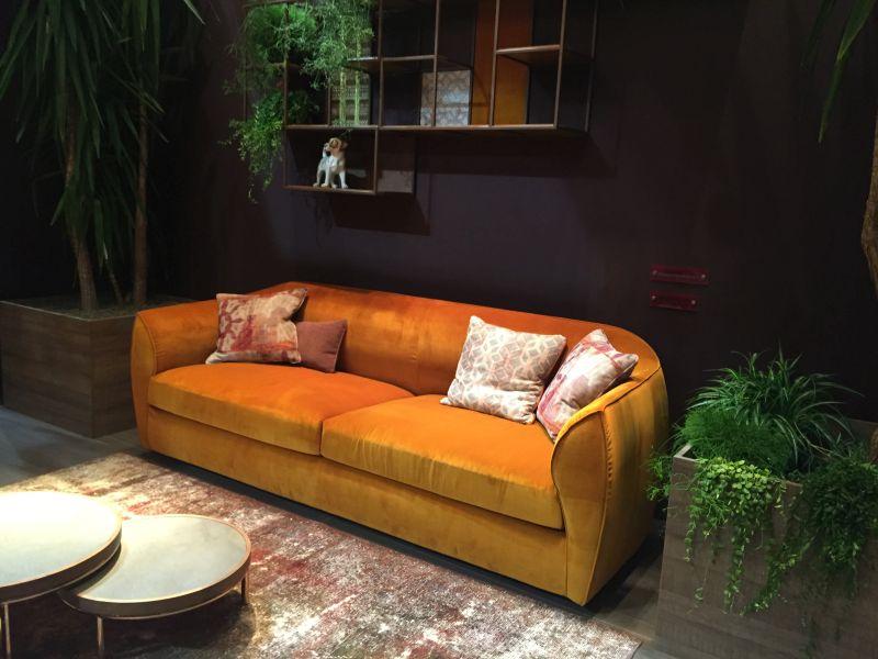 Orange velvet couch and plants