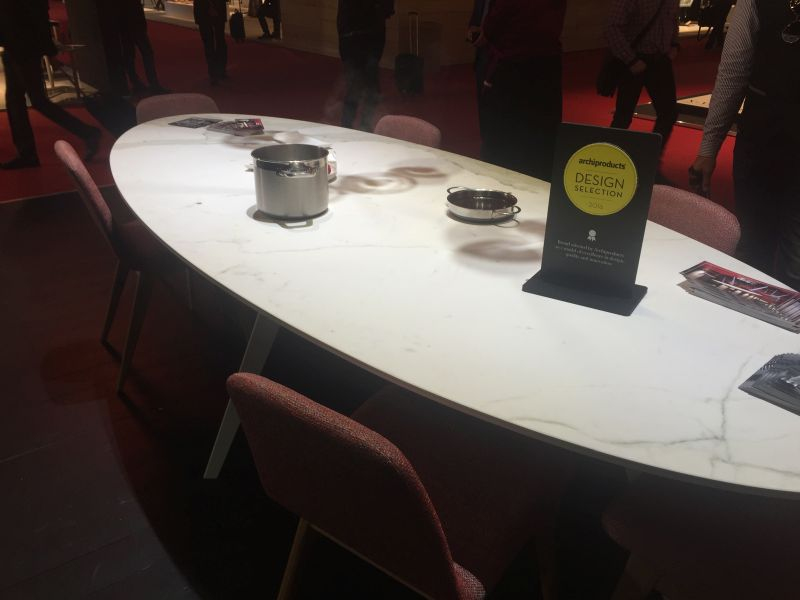Ova marble dining table with induction system