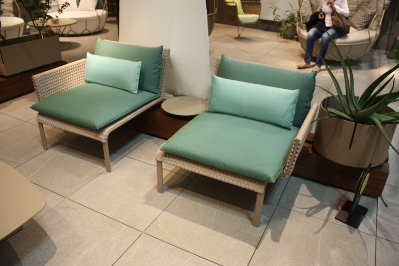 Part chair, part lounge, these chairs fit into a back base that can be customized with a small table in between or a large planter.