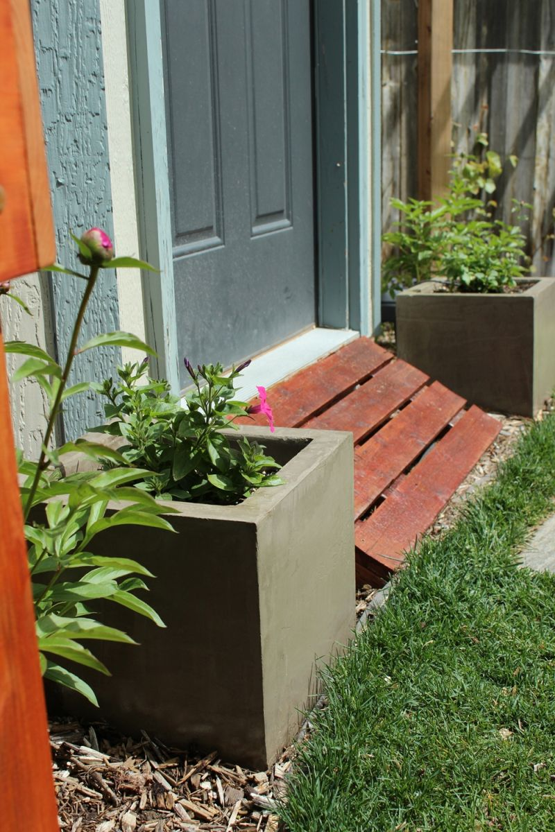 Place concrete planters in front of the house