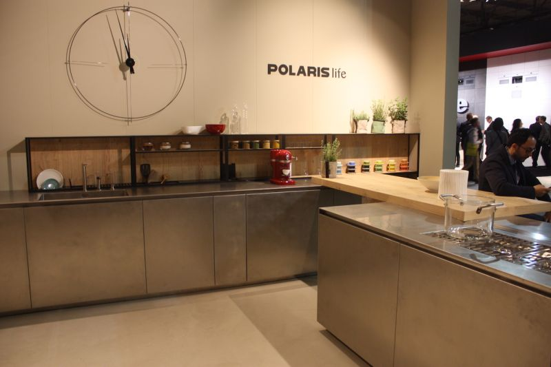Here, Polaris Life has teamed a minimalist cabinet design with a natural wood backing for the low open cabinet and a wooden butcher block countertop extension.