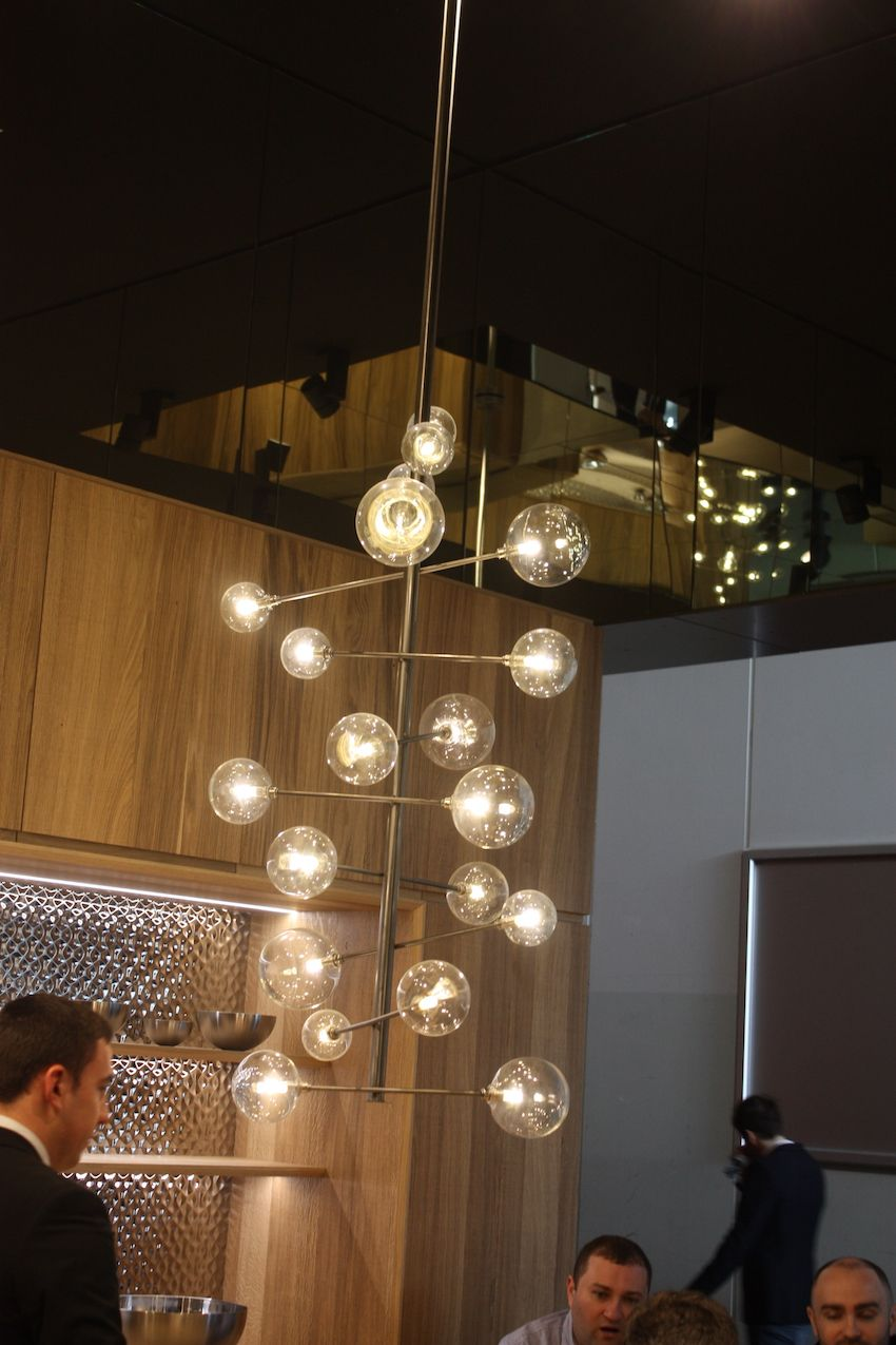 Porcelanosa's kitchen display included this mod kitchen light fixture. The round glass barbell-like bulbs on the horizontal arms look like a tower of bubbles. Fun and modern!
