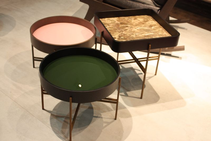 These side tables from Potocco are perfect for entertaining. The tray tops, which come in different colors and finishes, rest atop the base and can be used as a tray when needed.