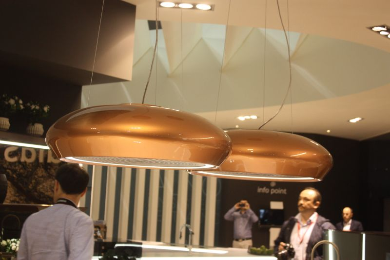 Similarly, jdias used a pair of these gold range hoods as kitchen island lighting.