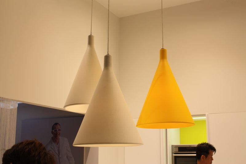 Every kitchen design can use a pop of color and that's what you get with these funnel-shaped kitchen pendant lighting fixtures. Rational Kitchen showed these as part of a modern kitchen decor.