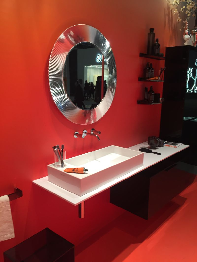 Red wall for bathroom with a cool mirror