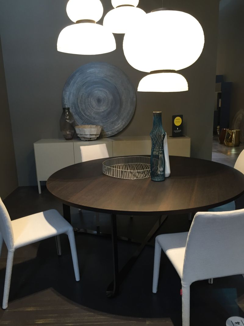 ... Round Dining Table And White Lighting Fixture