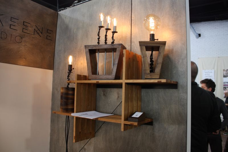 "This gorgeous collection is from Sam Keene. The woodworker created the shelving as well as the light fixtures, which are part of the ""Bits"" collection. Keene uses industrial drill bits in the design of these warm, vintage feeling light fixtures."