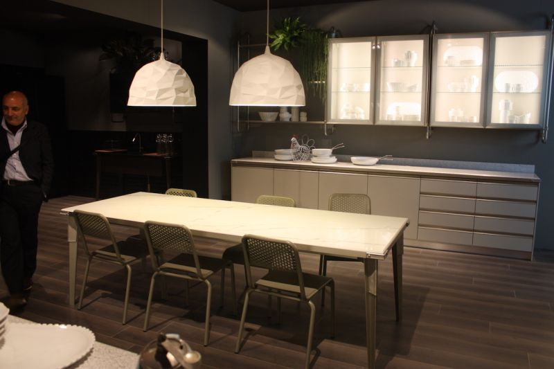 Kitchen pendant lights that look like they're made of crumpled paper are perfect over the table in this Scavolini kitchen.