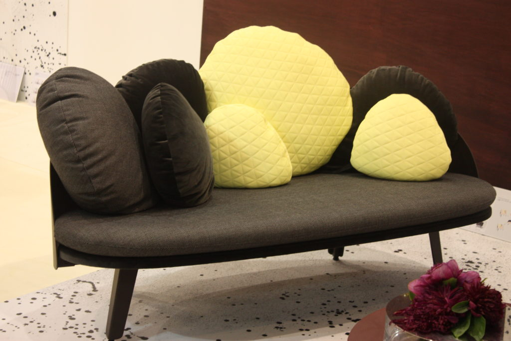Small couch in black with accents of yellow