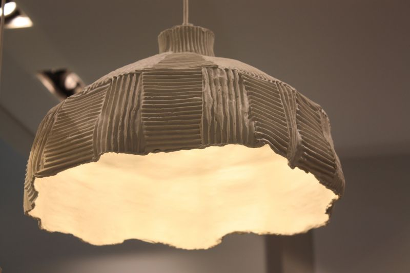 Snaidero showed this kitchen pendant light that has a hand-hewn feel.