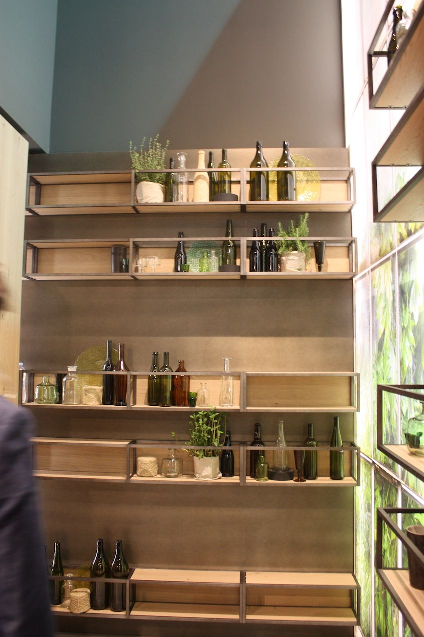 "Another example of open concept wood shelving is this wall unit shown by Snaidero. Instead of using only wood kitchen cabinets, the open box shelving units keep the feeling light and allow you to showcase items instead of hiding everything behind doors. This is a direct contrast to the recent trend of ""hidden"" kitchens."