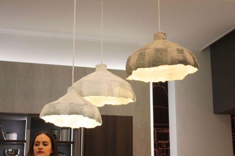 Rough, uneven and raw, these kitchen pendant lights in the Snaidero exhibit lend a natural feel to a modern space.