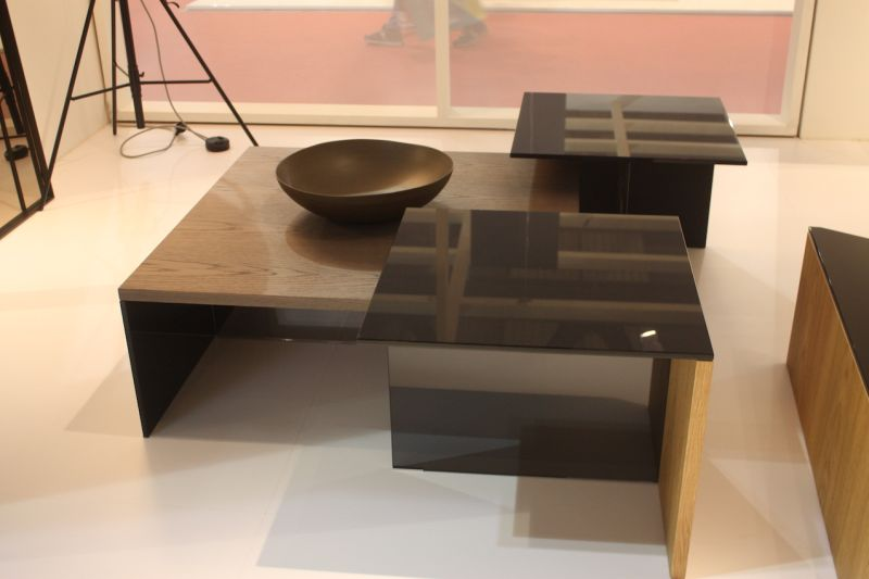 Sovet's Regolo Square coffee table is available in black laminated glass or wood. The variations feature the smoked glass and wood as either the base or the top.