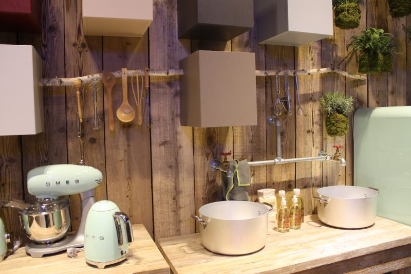 Stosa Cucine presented a retro kitchen that uses rustic wood walls, butcherblock countertops, and even a natural branch element as a utensil hanger.