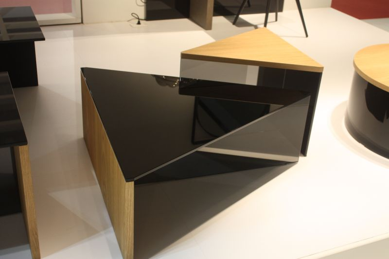 A Similar Design Is Their Triangular Coffee Table Set, That Includes Pieces  Of Various Heights