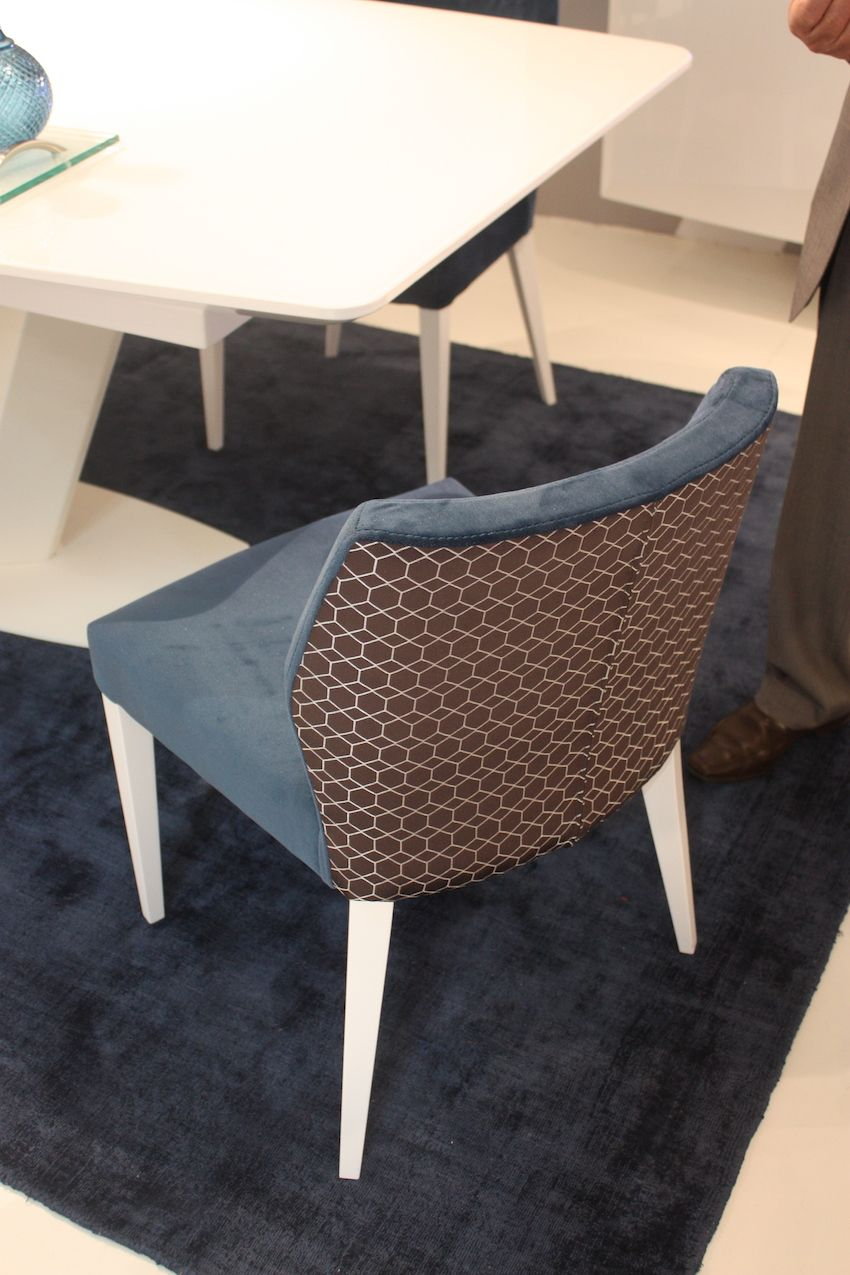 Another style of dining chair from Mobilario is upholstered in two different fabrics. The front is a solid colored suede and the back a printed fabric, a trend we're really fond of.