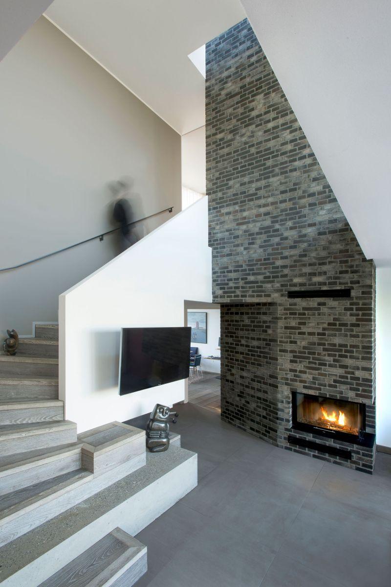 Villa U in Denmark fireplace wall