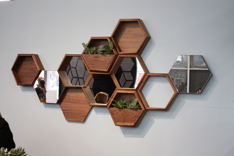 Think Fabricate's Wall-Nuts are a really fun concept. You can artfully arrange the different hexagons on the wall, according to whatever modules you want: shelving, mirrors, planters, etc.