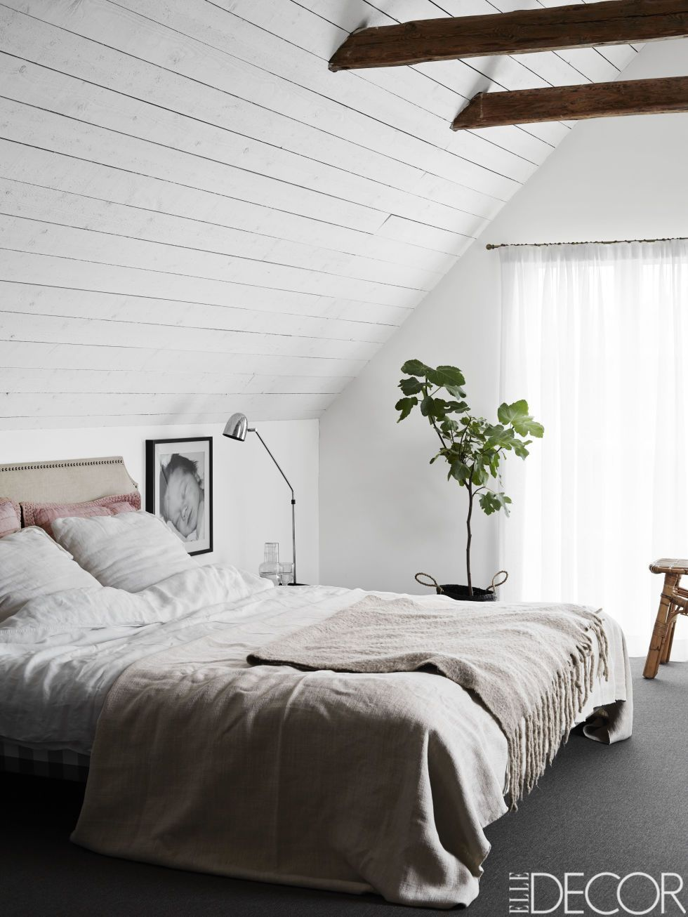 White washed attic bedroom